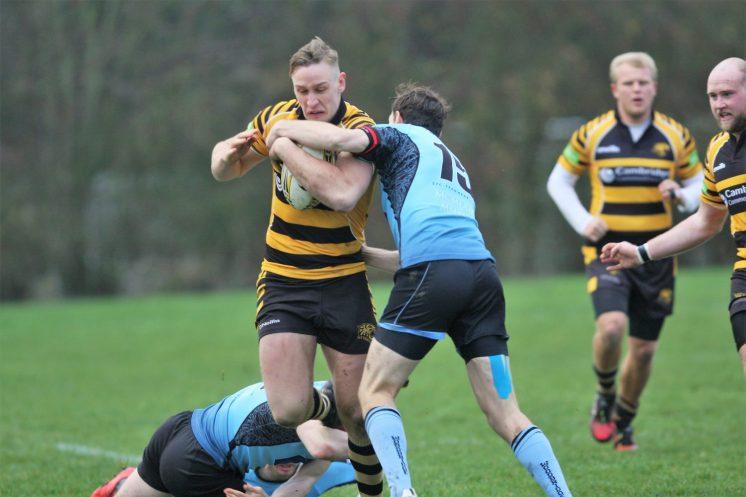 Matt McCarthy looks for a way past Woodbridge
