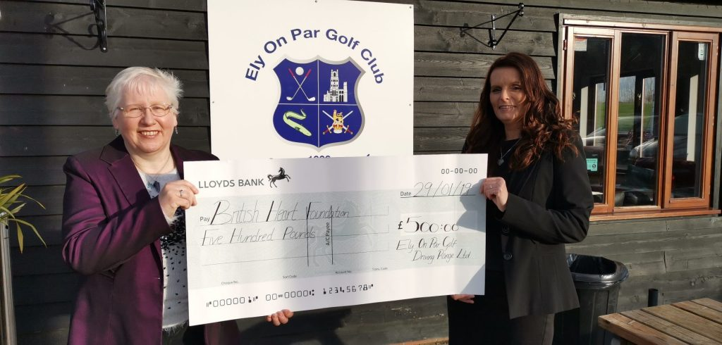 Tanya Ffitch - BHF Shop Assistant in Ely recieves a cheques from Zoe Habbin, Bar & Catering Manager at Ely On-Par Golf Course
