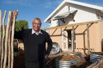 Mr. Pretorius in front of The Homestead Model