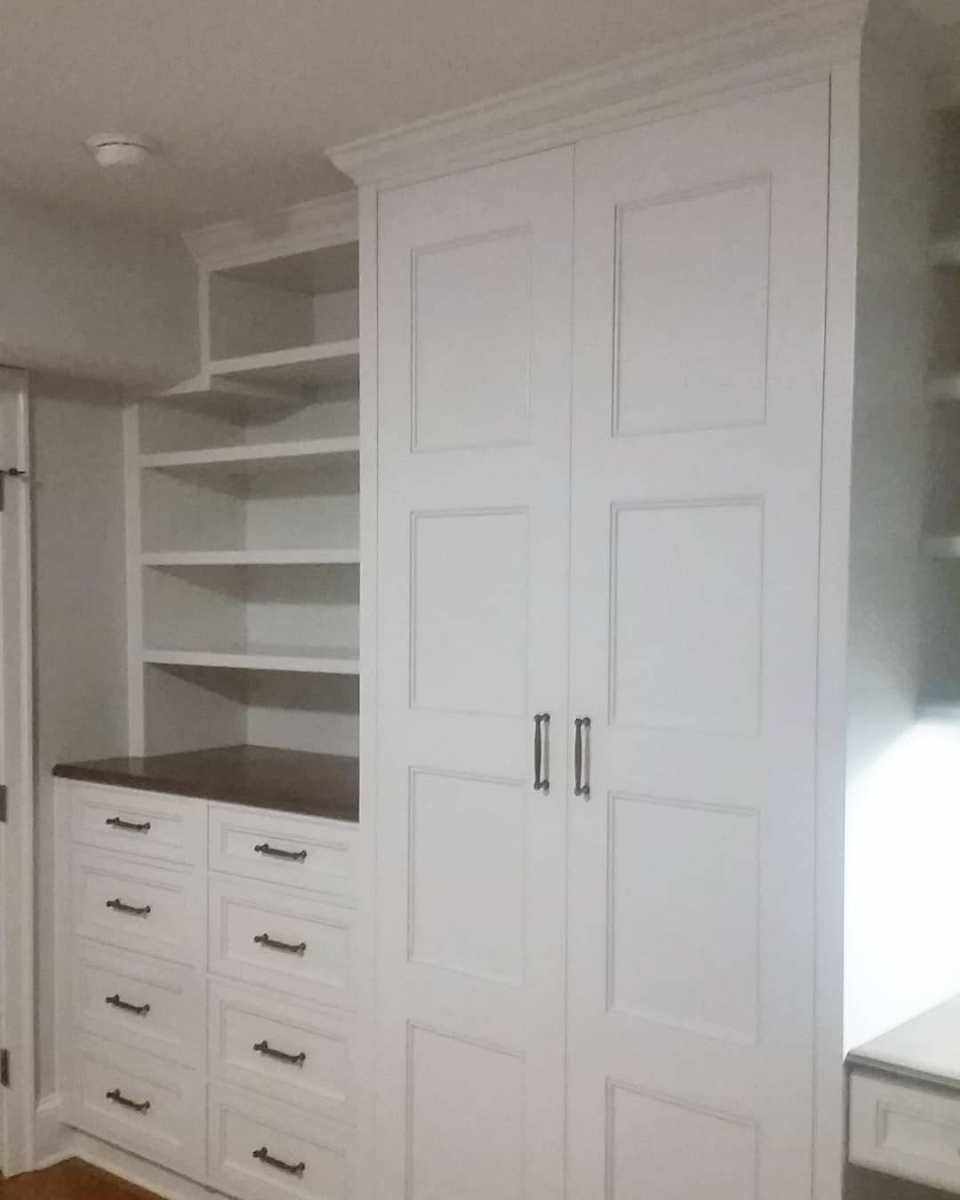 White custom closet and built-in dresser