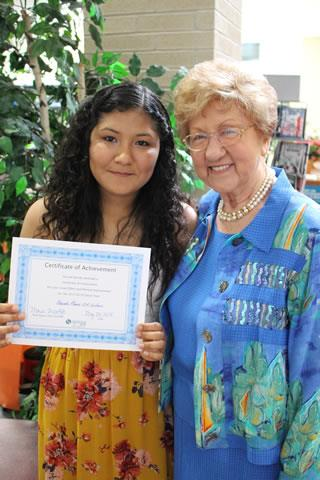 Claughton Middle School Seventh-Grader Alexandra Moreira stands with the school's namesake, Stelle Claughton Lacefield, following the Spring ISD Newcomer Program 2017-18 graduation ceremony.