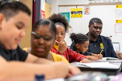 Justin Jones in a classroom with students at Link Elementary School
