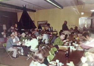 Early 70's campers enjoying a meal in the Lodge.