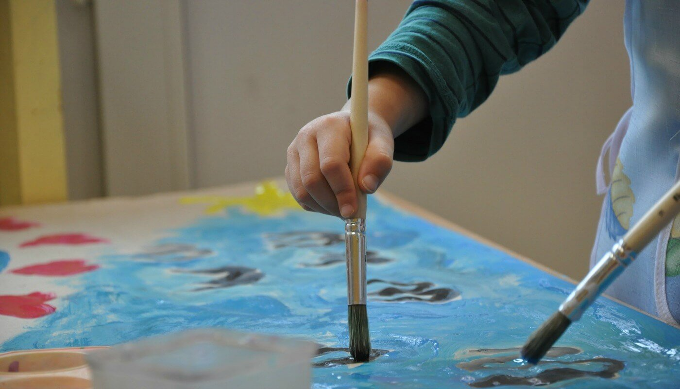 a child paints