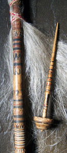 Spindle next to top of distaff with flax