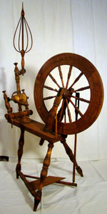"Spinning wheel marked ""H. Zuber"""