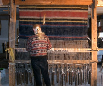 "Norman Kennedy weaving a blanket on 82""-wide warp-weighted loom. Large wooden frame. Window weights provide tension on handspun warp."