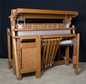 Bergman loom with treadles up, and the front folded