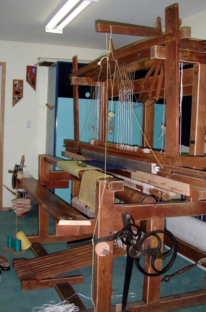 "60"" 12-shaft loom built by Andeas Kohmann in Bamberg, Germany. Side view shows automatic take-up system."