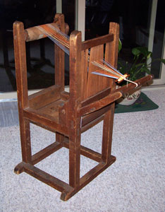 Tape loom on a frame.