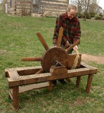 Bro. Christian using scutching wheel ca. 1994.
