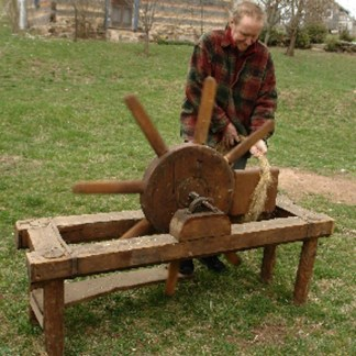 Bro. Christian using scutching wheel ca. 1994.