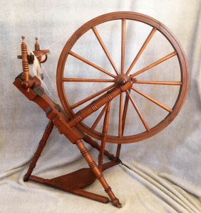 Norwegian spinning wheel with sliding metal tension system.