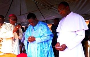 (L-R) The Catholic Archbishop of Onitsha, Most Rev Dr. Valerian Okeke bestowing blessings on the Governor of Anambra State, Chief Willie Obiano during a visit to St Kizito Girls Secondary School, Umudioka, Dunukofia LGA, Anambra State...at the weekend.