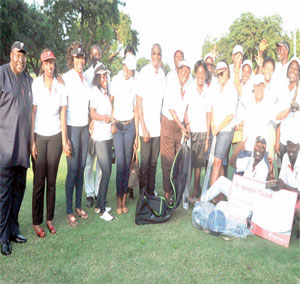 A group picture of winners of the day and officials of Kenyan Airways.
