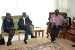 Former President Kufuor (right) interacting with  Mr Linus W. Gitahi (middle