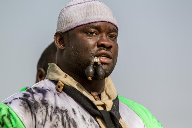 "Eumeu Sene performs mysterious ritual before the Senegalese traditional wrestling match ""Le Choc"" at Demba Diop Stadium, Dakar, capital of Senegal, April 5, 2015. Thousands of audience have watched the biggest match here on Sunday at the beginning of the wrestling season with the most famous wrestlers Balla Gaye 2 and Eumeu Sene competing. Eumeu Sene won the match at last. (Xinhua/Li Jing)"