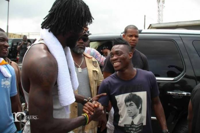 Adebayor with Christian Atsu