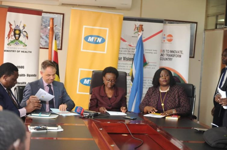 MTN Bosses with Minister Jane Ruth Aceng