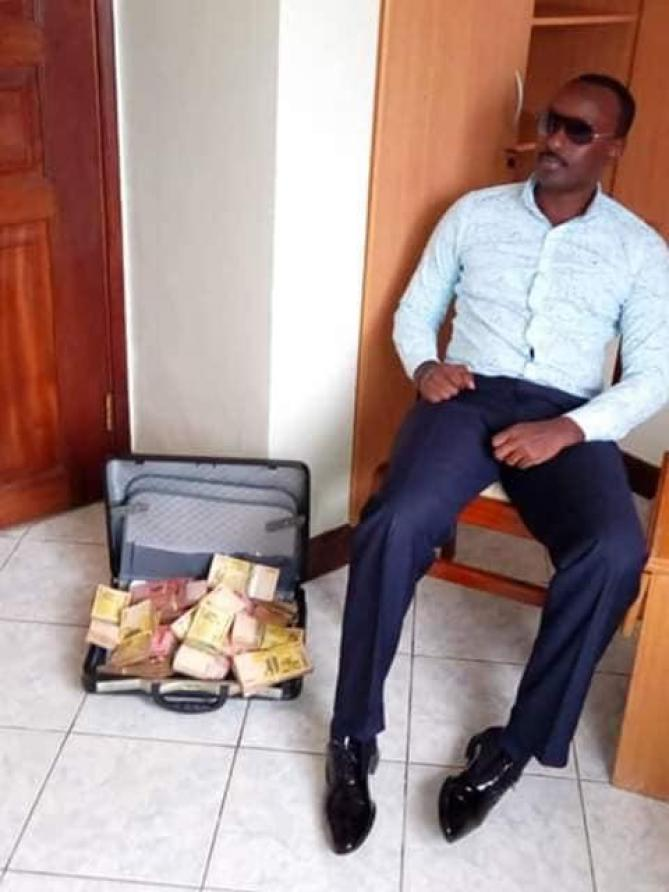 Joshua chilling with a briefcase full of money