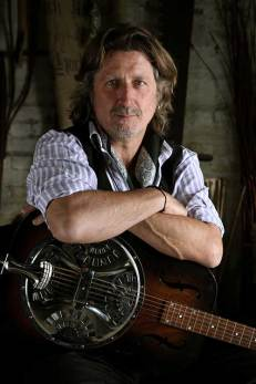 Steve Knightley sitting with guitar