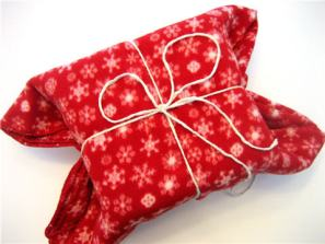 Image result for gift wrapped in blanket