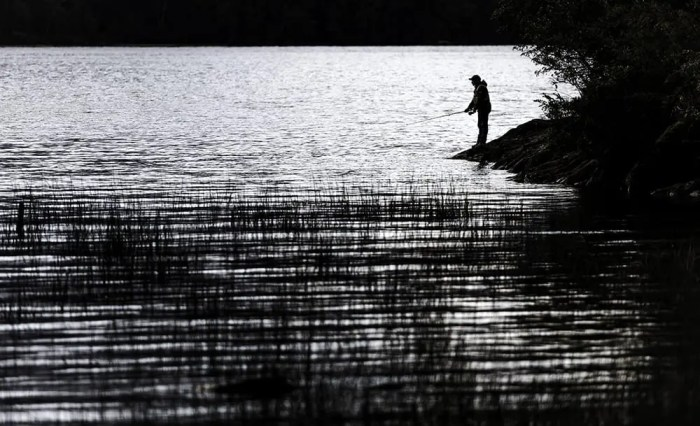 Fisherman by the lake