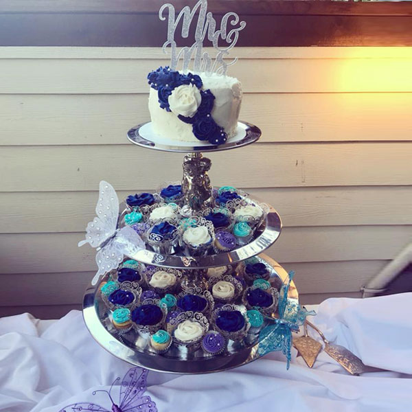 3-tier silver serving piece shown displaying cupcakes