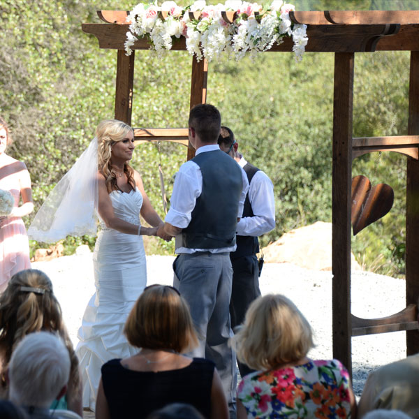 Fruitwood arch with bride and groom