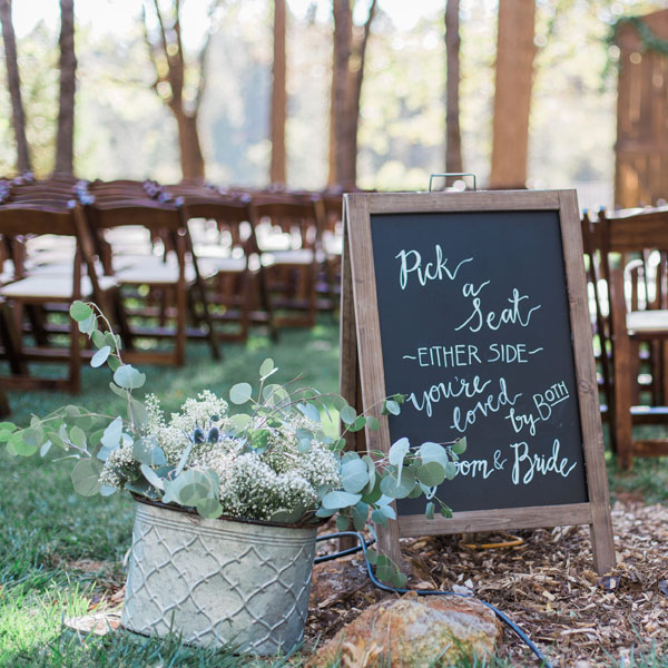 Fruitwood padded folding chairs with chalkboard sign