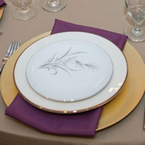 Mixed vintage china with Victoria and gold charger place setting