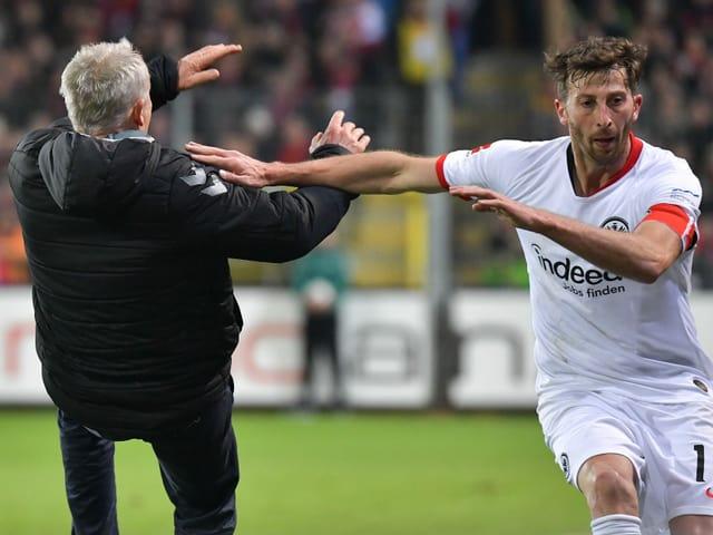 Freiburg captain David Abraham rams Christian Streich.