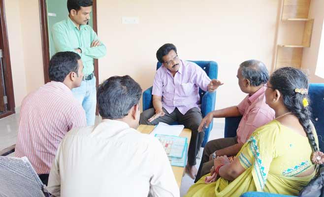 Explaining to customers about Akshaya Gardens in Mela