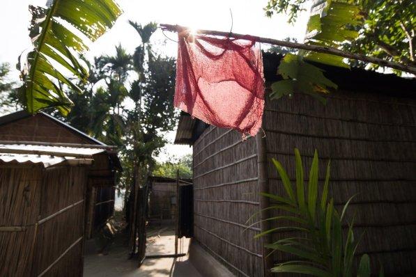 A red flag outside a house serves as a sign of presence of Bodo families in a Bodo-majority neighbourhood in Bhowraguri, Kokrajhar, Assam.
