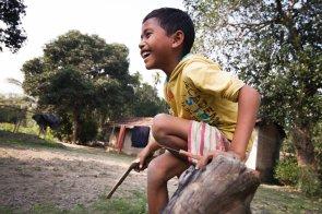 A child plays with a wooden gun in Aminkhata, Kokrajhar, Assam.