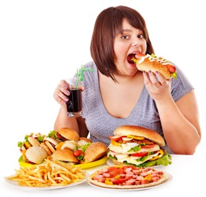 2-Overweight-woman-eating-fast-food-it-is-the-worst-food