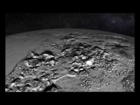 nasa animated flyover of pluto icy mountain and plains