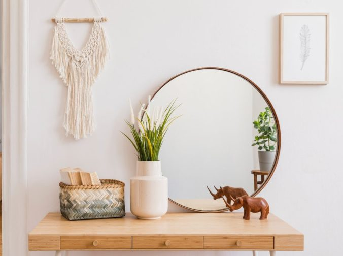 entry table with mirror and decorative accessories