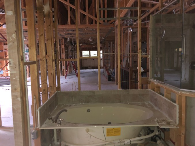 Master bath renovation before image with original tub and shower location