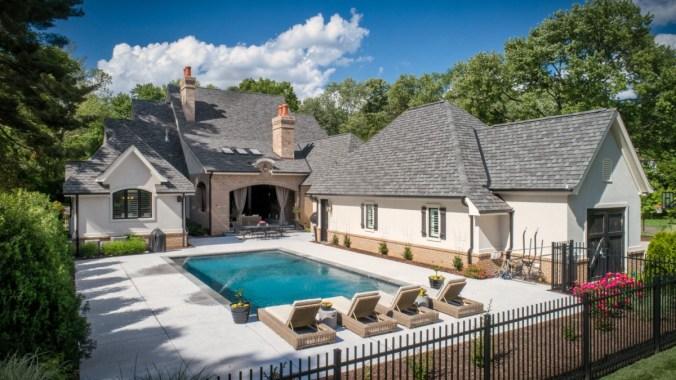 Custom home with rear courtyard pool terrace design