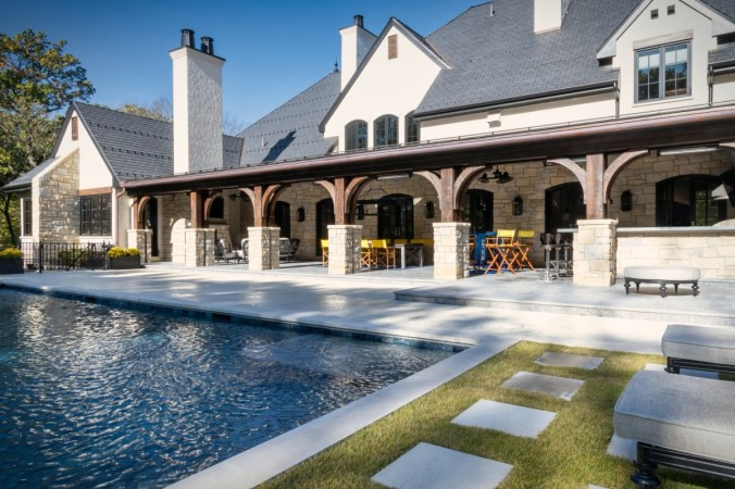 Home design with covered outdoor living area and pool deck