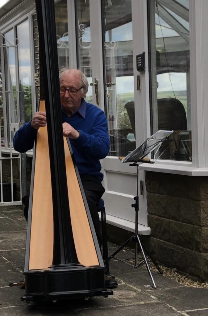 Frank Wood performing on the concert harp for residents at Thornton Hill, adhering to all social distance guidance. Feedback included 'This morning the residents were full of compliments for the harpist ye