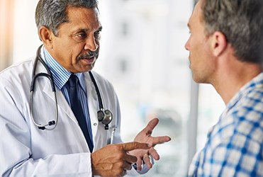 male doctor talking to man