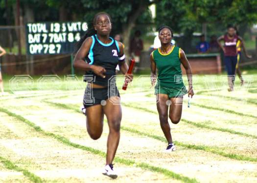 Mufaro Hungwe takes her team home in the U20 girls 4x100m relay with Lomagundi's Sakhile Donga in hot pursuit