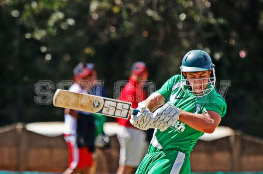 Andrew Lake of St John's pulls one to add runs on the board for his team against Peterhouse