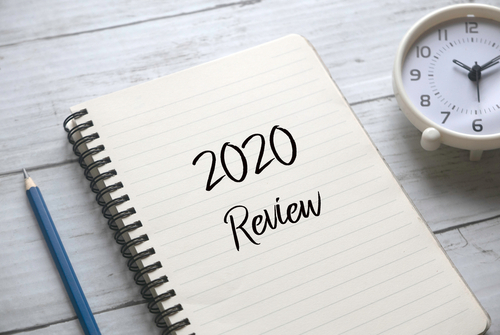 notepad and pen with title review 2020