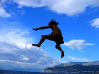 Justin leaps into the Mediterranean from a cliff in Serrento.