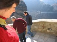 Judy, John, and Curtis descend from the mountaintop monastery at Meteora