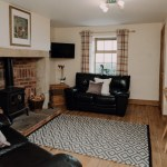 Stablewood Coastal Cottages Grayling Living/Dining Room