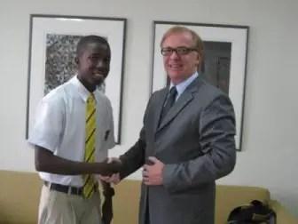 Canadian High Commissioner to Guyana David Devine congratulating Glinton Hanover.